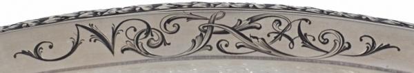 Ваза смонограммой «NKA». Россия, Москва, фирма Ф.А.Лорие, мастерская Е.Черятова. 1908-1917. Серебро, чеканка, стекло, 35×19×5,5см.